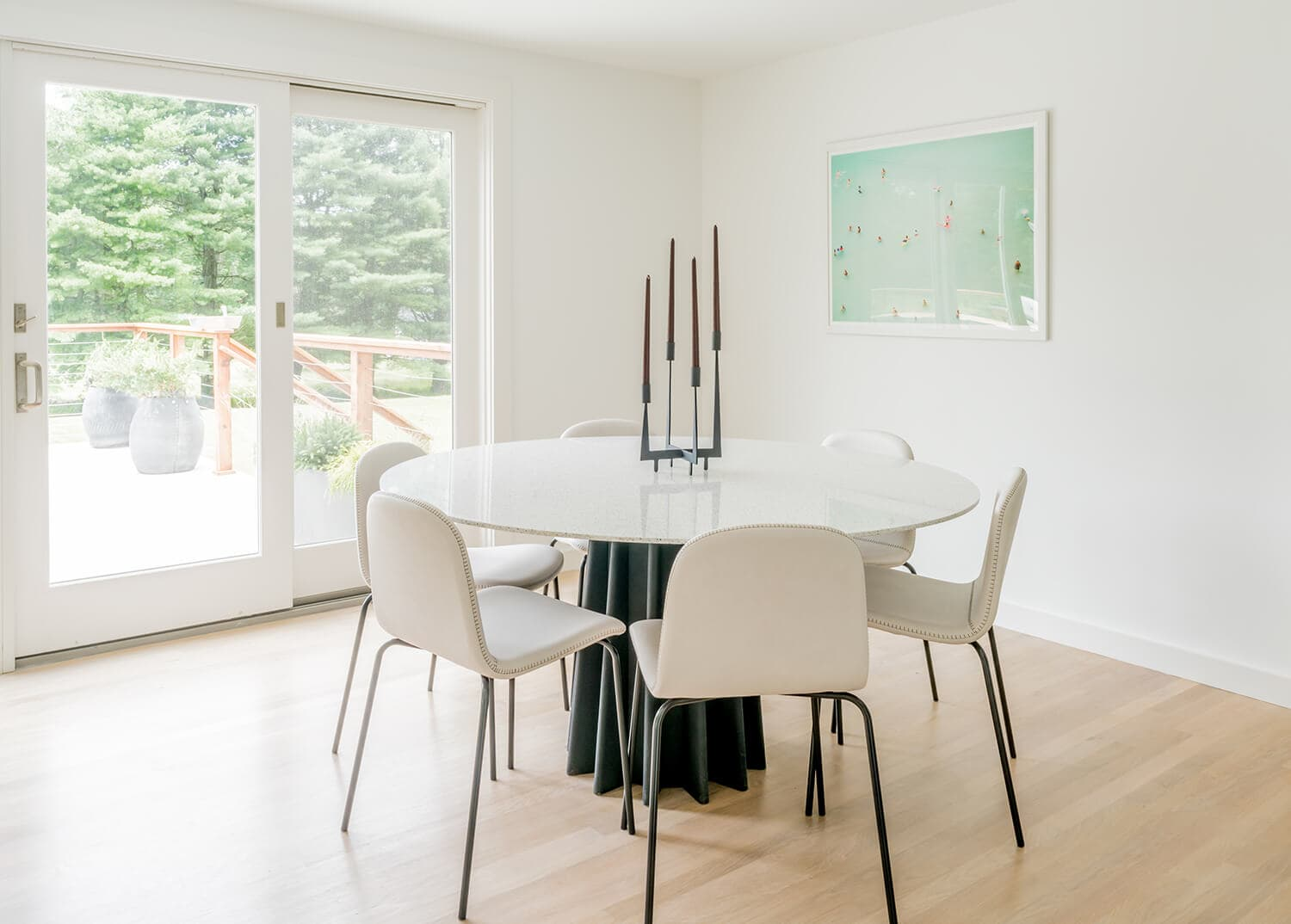 Modern white furniture in a light, bright dining area. Mountainside Addiction Treatment Center.