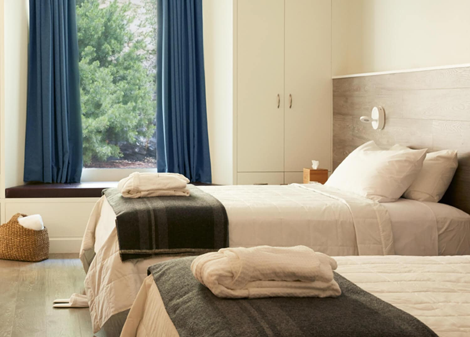 Modern, clean bedroom with two twin beds. Detox program accommodations at Mountainside Treatment Center in Canaan, CT.