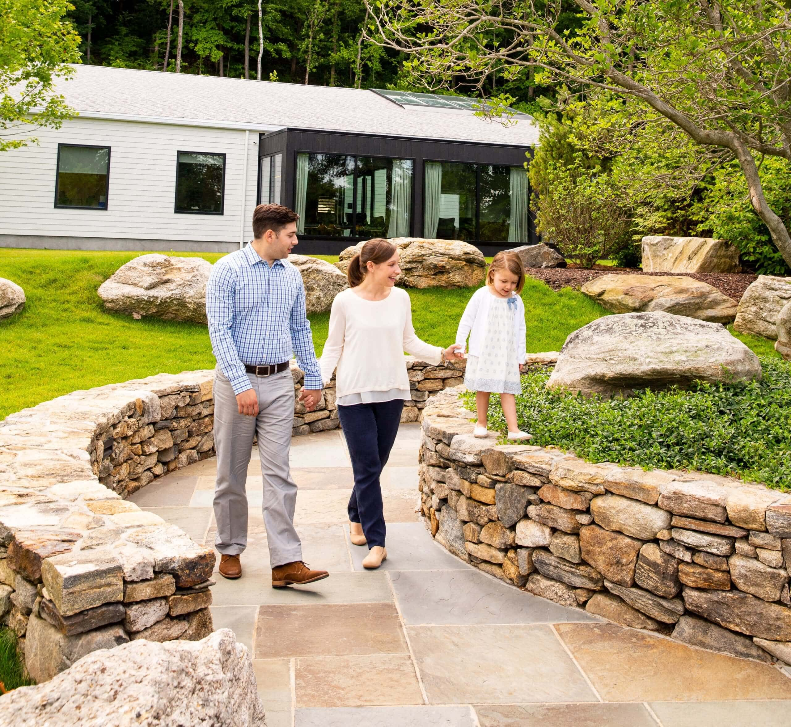Family strolling in Mountainside's Addiction Treatment Center's Courtyard
