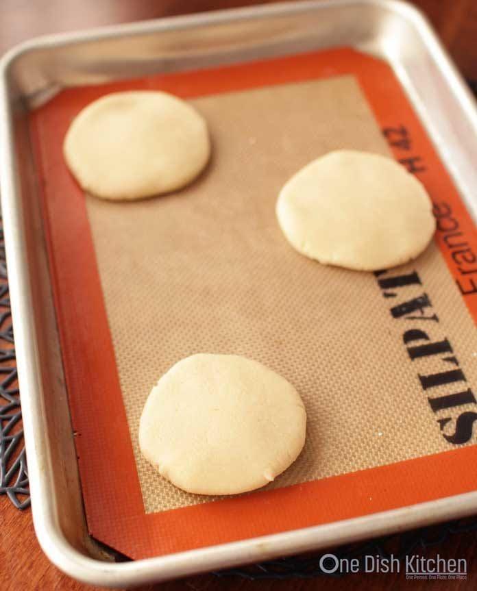 Flattened shortbread cookie dough on a baking sheet