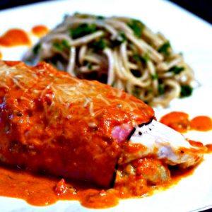 Chicken Stuffed With Artichoke In Tomato Basil Sauce
