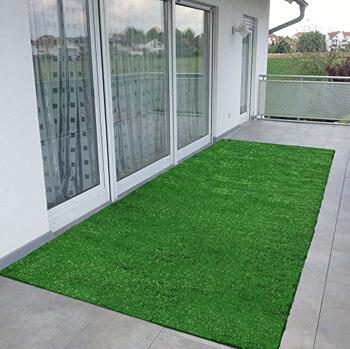 5. Ottomanson Evergreen Collection Indoor/Outdoor Green Artificial Grass Turf Solid Design Runner Rug 2'7