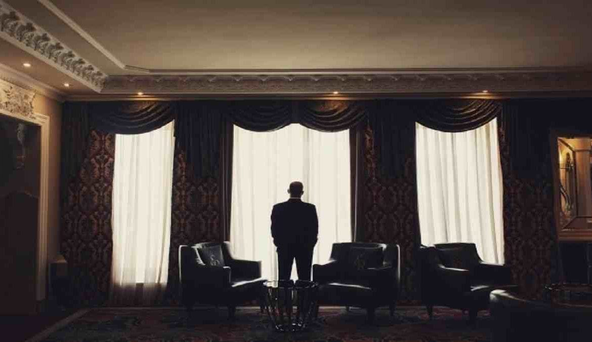Lonely man stands - The greatest paradox of being wealthy