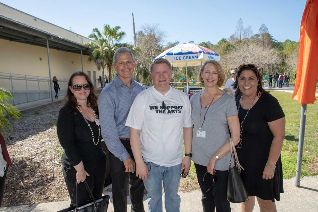 Pinellas Community Foundation CEO smiles with attendees