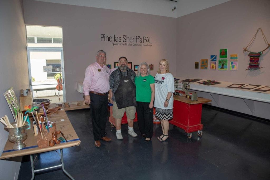 Pinellas PAL volunteers showing their work