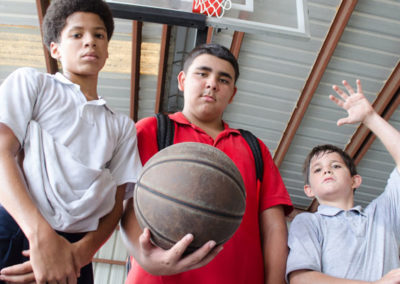 Three boys ready to play basketball.