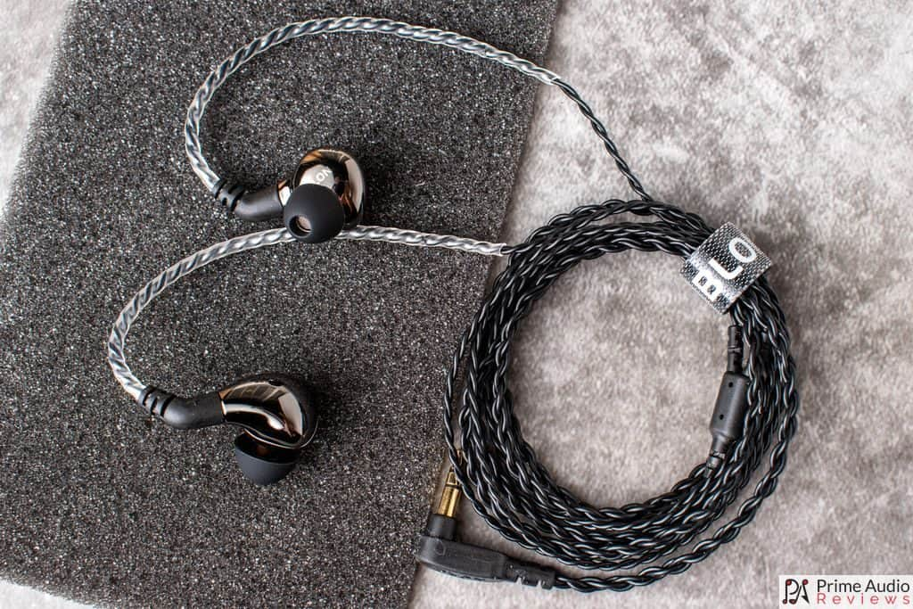 Top-down view of earphones with cable attached