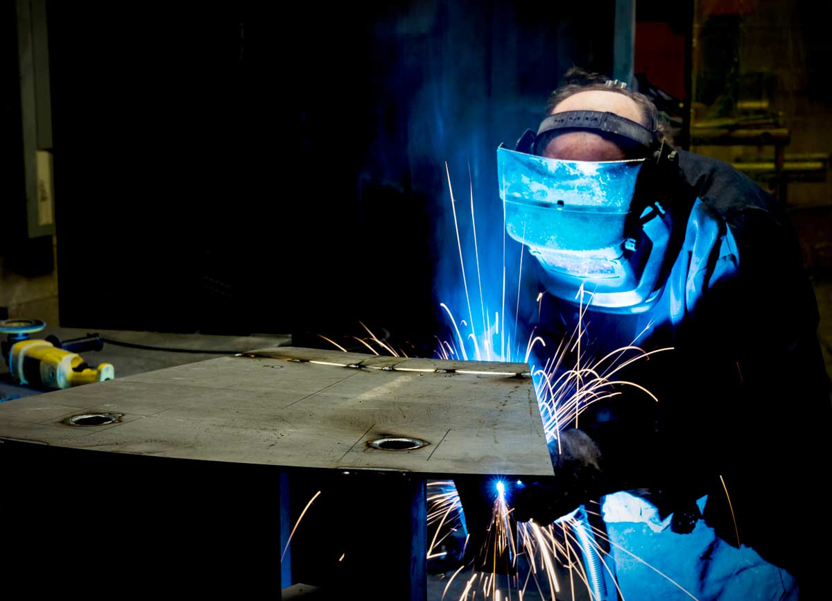 Man spot welding at Spike Electric in Houston, TX