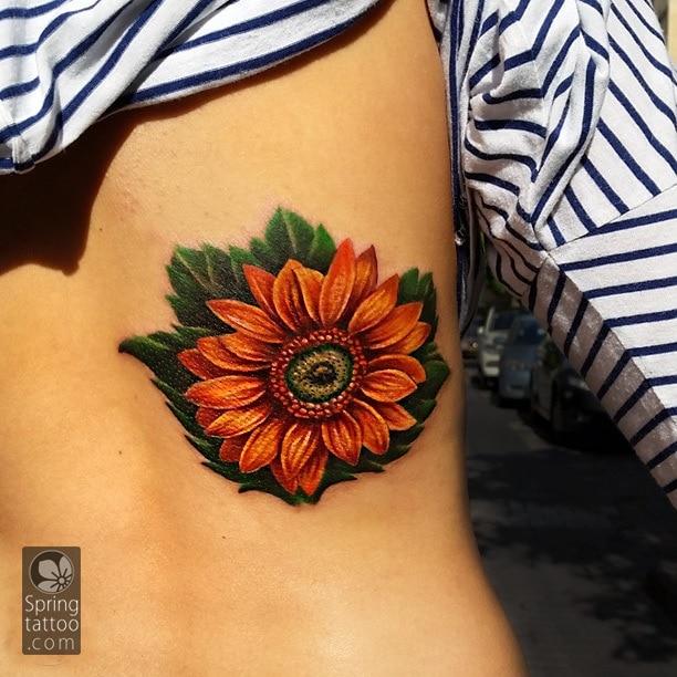 sunflower tattoo by Aviv Rotshas