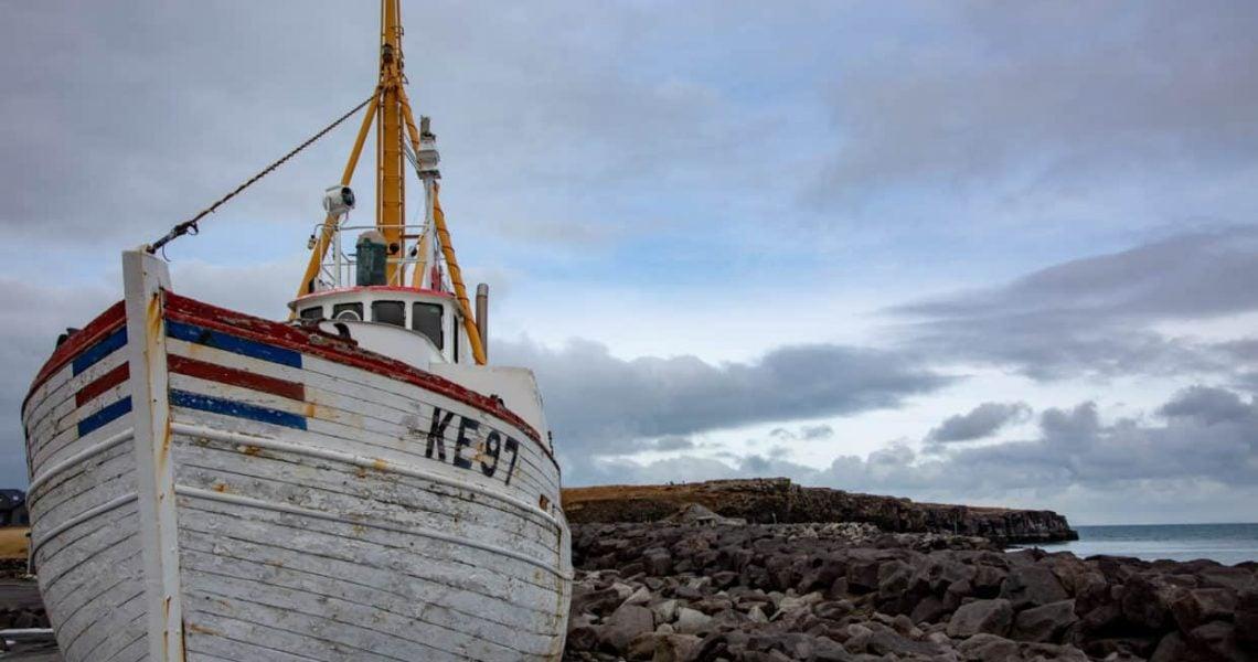 Stonetree Creative - Boat on Rocks in Iceland