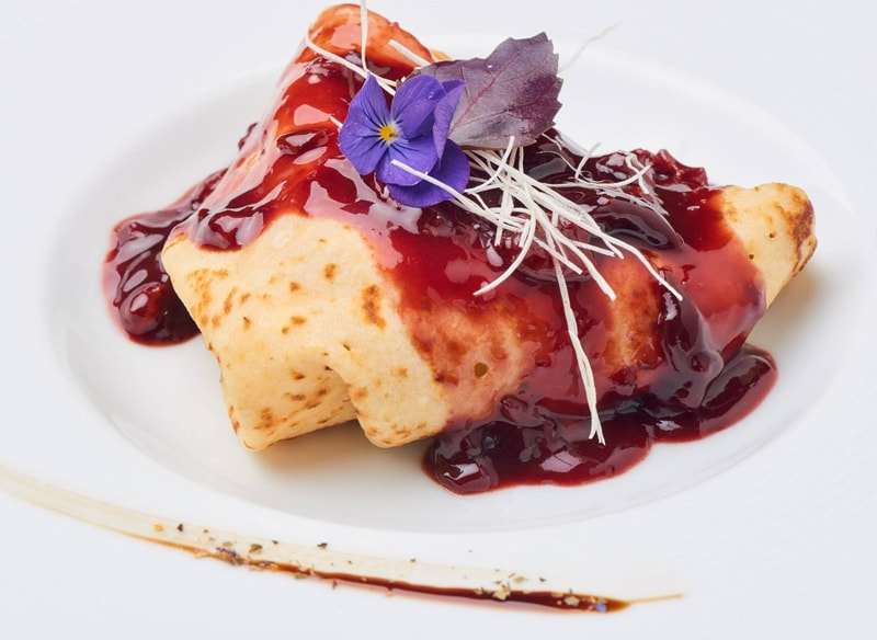 Pancakes with hot plums and Ice cream vanillia