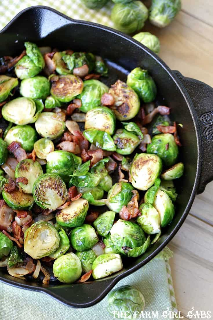 Pan Seared Brussels Sprouts With Bacon are a super quick side dish ready in 20 minutes flat! It's the perfect recipe to serve at Thanksgiving or for a weeknight meal. #SideDish #Recipe