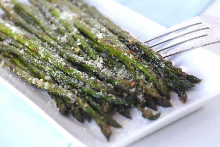 Roasted Asparagus with Garlic & Parmesan is a quick and delicious vegetable recipe. You can't go wrong with fresh asparagus, garlic and parmesan!