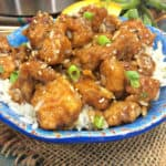 Ready in 20 minutes, this Instant Pot Orange Chicken recipe is a delicious option to ordering Chinese take-out. Raise your hand if you love Instant Pot recipes! #InstantPot #OrangeChicken #InstantPotRecipe #EasyMeal #ChineseFood