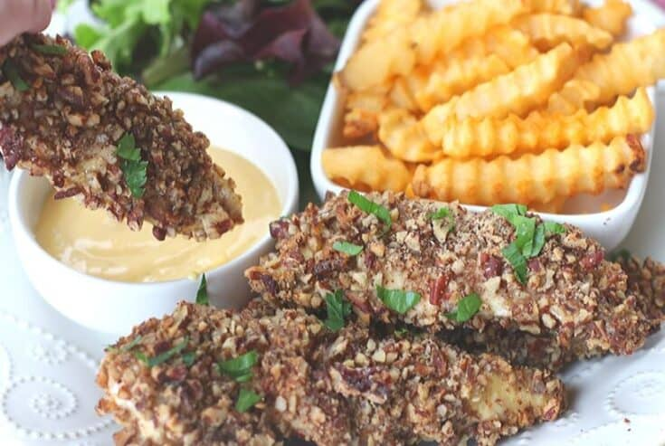 This baked Pecan Crusted Chicken recipe has a whole lot of flavor and a delicious pecan crunch. Enjoy these chicken tenders as is, with dipping sauce or on top of a salad.
