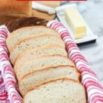 This Homemade Country White Bread makes two delicious loaves of bread. This easy bread recipe is perfect for sandwiches, toast or just a smear of butter.