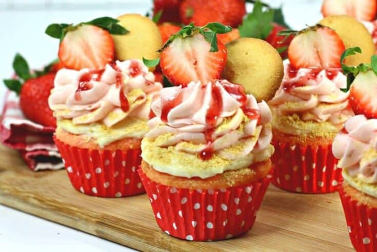Are you fan of Strawberry cheesecake? These Strawberry cheesecake cupcakes are a fun twist on the classic. A Strawberry cupcake, fresh strawberries and a delicious cheesecake filling pair to make these delicious Strawberry Cheesecake Cupcakes. This strawberry cheesecake cupcake recipe is a real winner. Make this easy cupcake recipe for Valentine's day, birthday or just because. Celebrate strawberry season and make a batch of these pretty cupcakes.