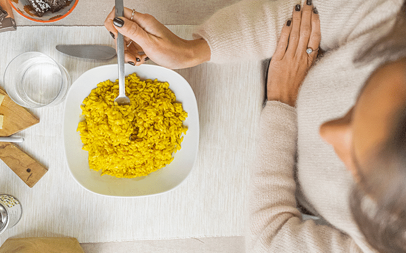 Girl eating risotto