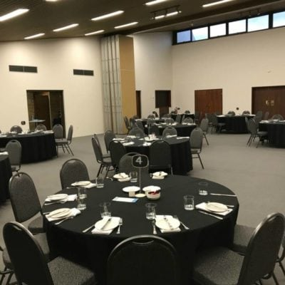 Tables In Function Room Ready For A Business Event.