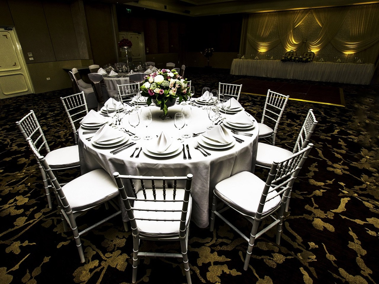 Banquet Style Setup inside the Function Room and a Long Table in Front
