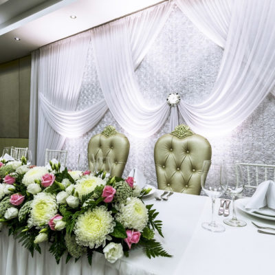 Table and Chairs with Flowers and Backdrop