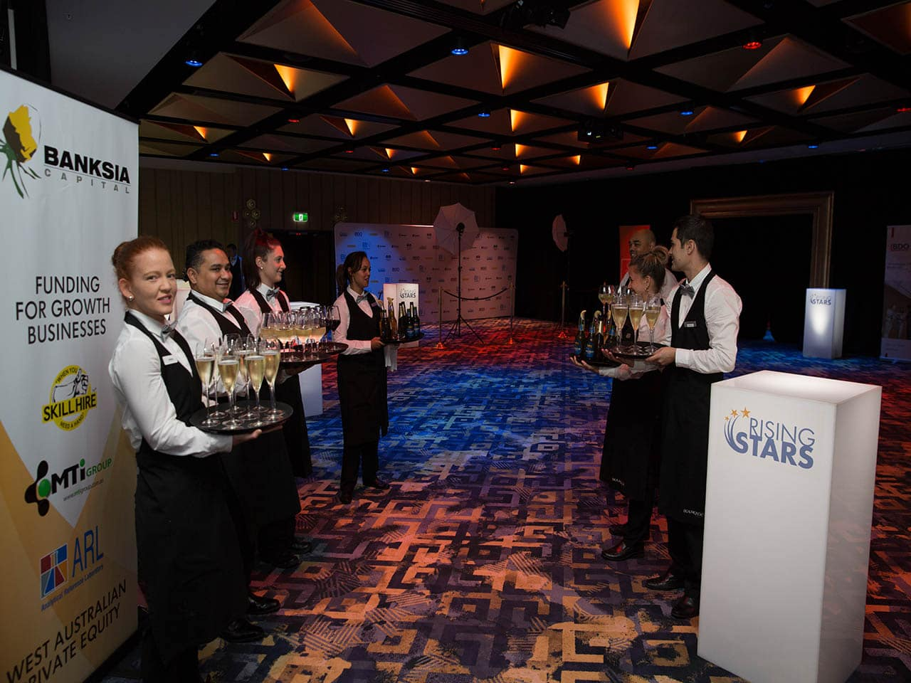 Wait Staff Waiting At The Entrance To The Function Room With Drinks For The Guests