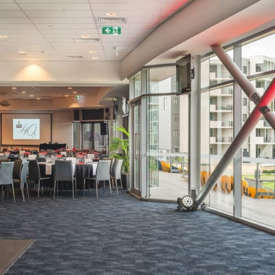 Inside The Function Room With Chairs And Tables In Banquet Style, Projection Screen And Outside View On The Right Side