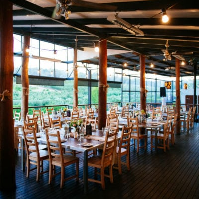 Chairs And Tables Inside The Function Room With Wine Cask On The Side, Hanging Lights And Perth Hills View