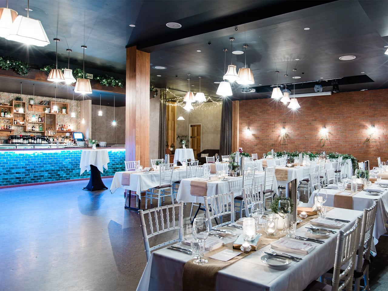 The Gallery set up for wedding with long white tables