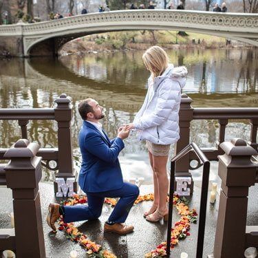 Marriage Proposal by Bow Bridge in Central Park.