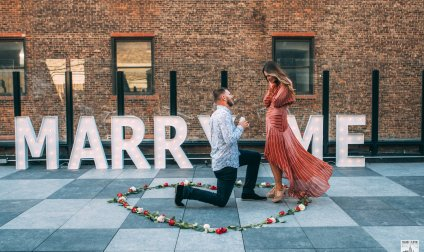 Large Marry Me letters Proposal on a Private Rooftop