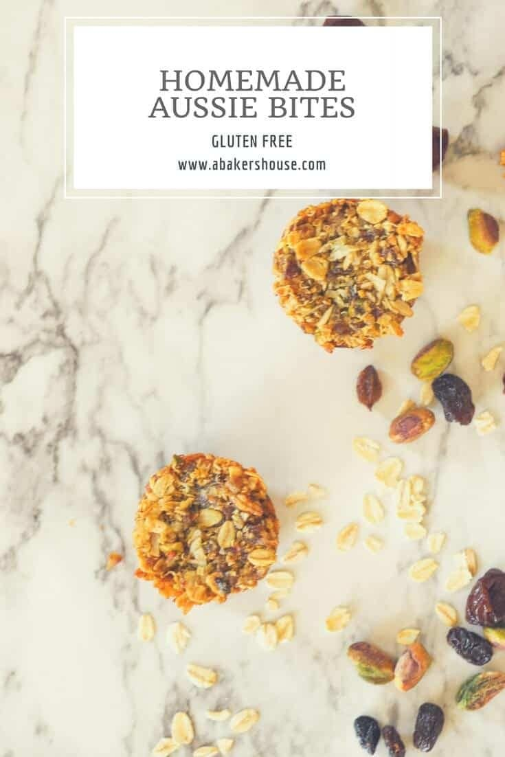 Loaded Homemade Aussie bites are a copycat aussie bites recipe that take the Costco favorite and makes a gluten free aussie bite filled with your favorite dried fruits and nuts. Whole grains of oats and quinoa are the base of these energy bites. Apricots, dried cherries, raisins and pistachios add to the flavor. #abakershouse #aussiebites #Recipe #aussiebitesrecipe #driedfruit #bakingwithnuts #glutenfree #glutenfreebaking #copycatrecipe #energybites