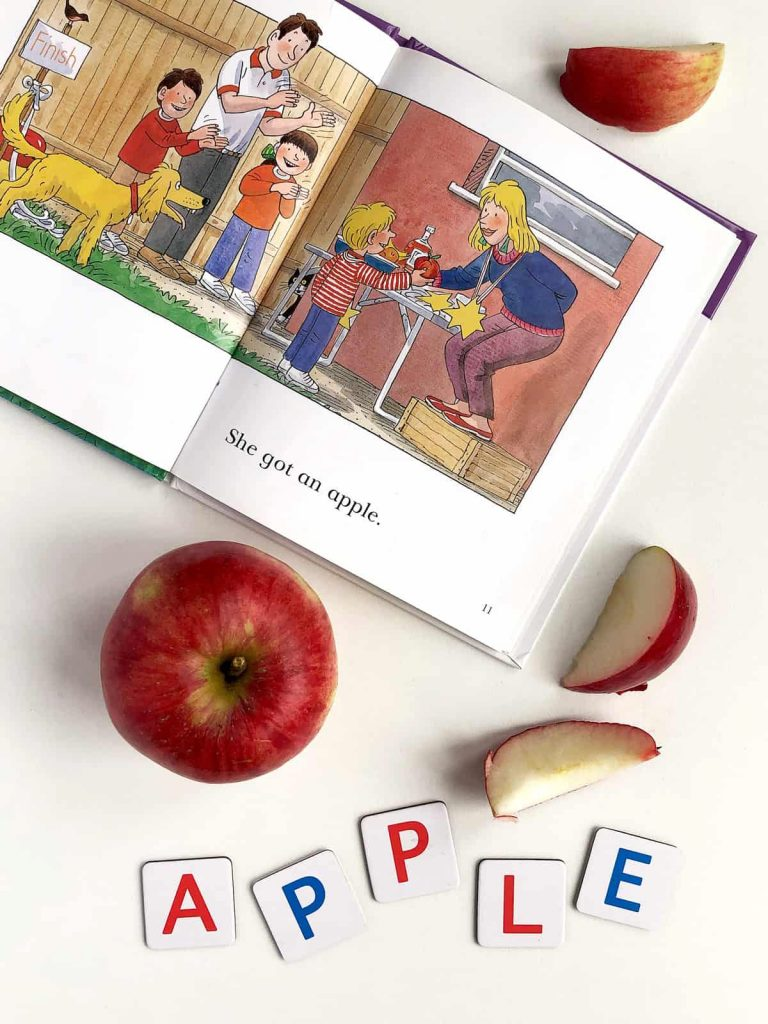a book, apple and letters