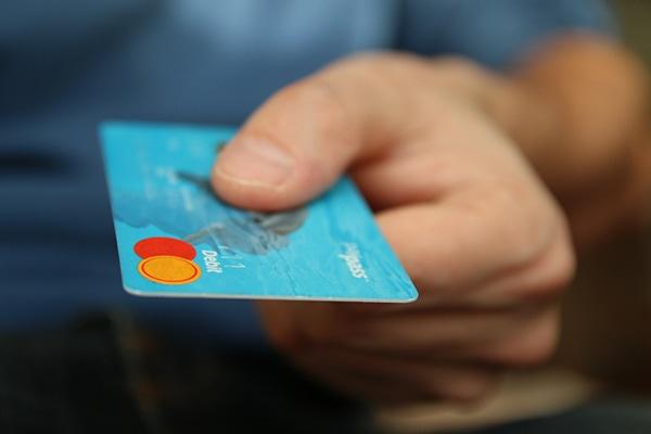 Man holding a debit card