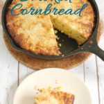 a skillet of smoked cornbread with text overlay for pinterest
