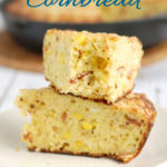 two pieces of smoked cornbread on a plate with text overlay for pinterest
