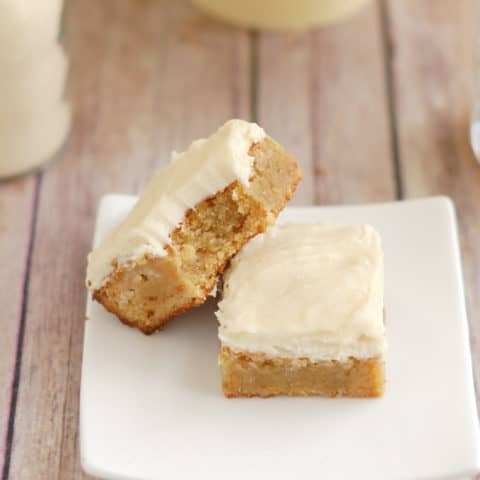 two malted milk blondies on a white plate