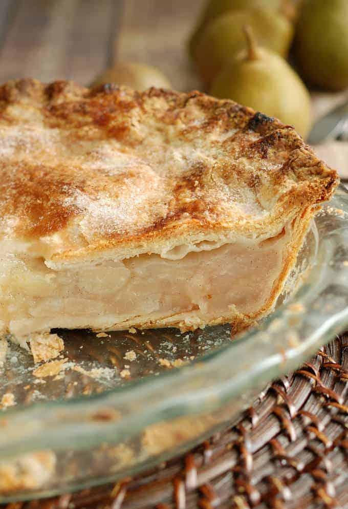 closeup shot of a pie showing the flaky sourdough pie crust