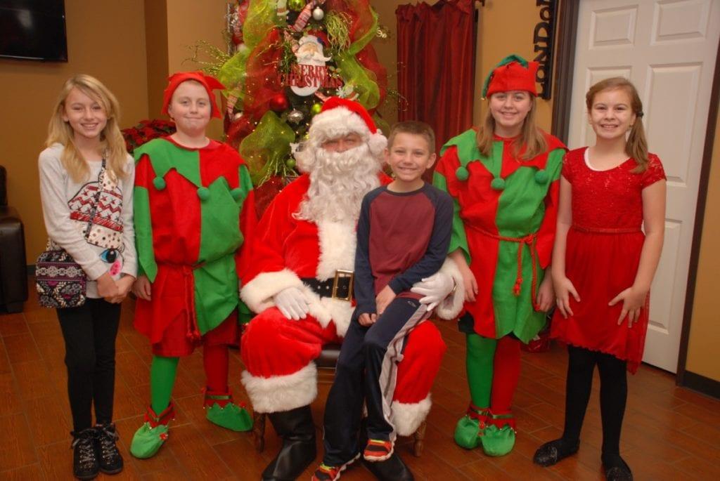 Santa brings his helpers