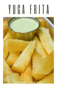 Yuca frita served with a light green cilantro sauce.