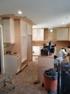 During: refinished kitchen cabinets project team working