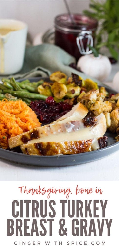 Complete Thanksgiving meal with sliced turkey breast and gravy. Pinterest pin.