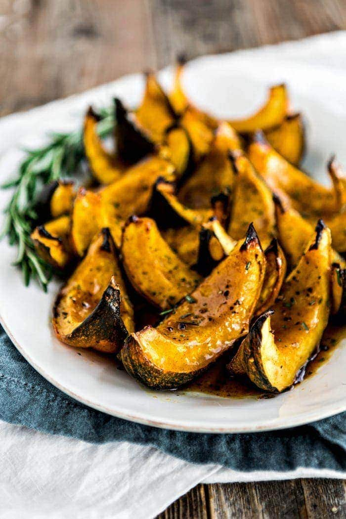 roasted acorn squash on white serving platter