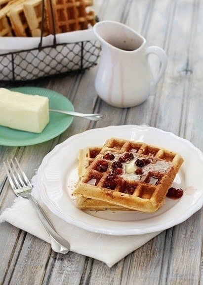 Whole Wheat Flax Waffles with Cranberry Orange Maple Syrup | I took my favorite waffle recipe and reduced the sugar, plus added flax. They have some great health benefits now so I wouldn't hesitate to serve them at any meal of the day!
