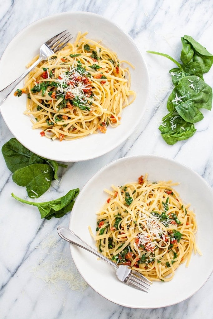two bowls of spinach and sun dried tomato pasta