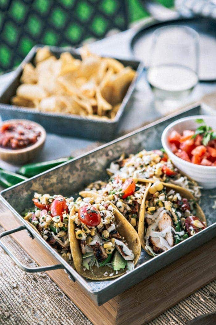 Try a fun summer take on tacos with this recipe for Chicken Tacos with Grilled Corn Tomato Salsa. Chicken is flavored with a tasty Chipotle Lime Marinade and then grilled. Instead of traditional salsa, fresh, sweet summer corn is grilled until charred and combined with tomatoes, jalapeño, onion, and cilantro.