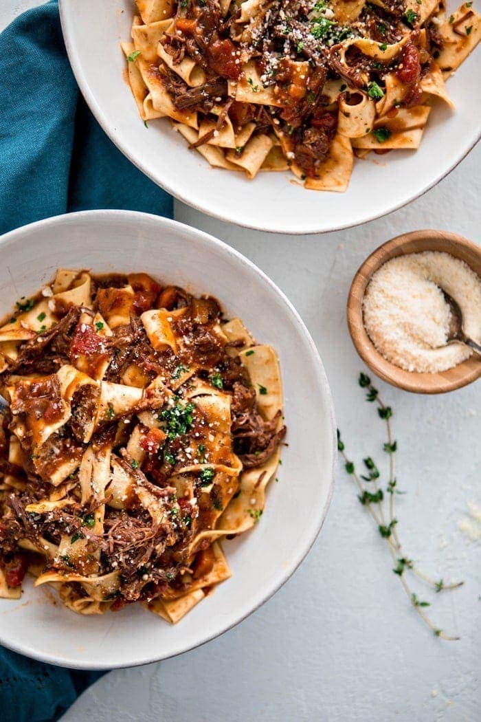 two bowls of beef ragu with fresh pasta