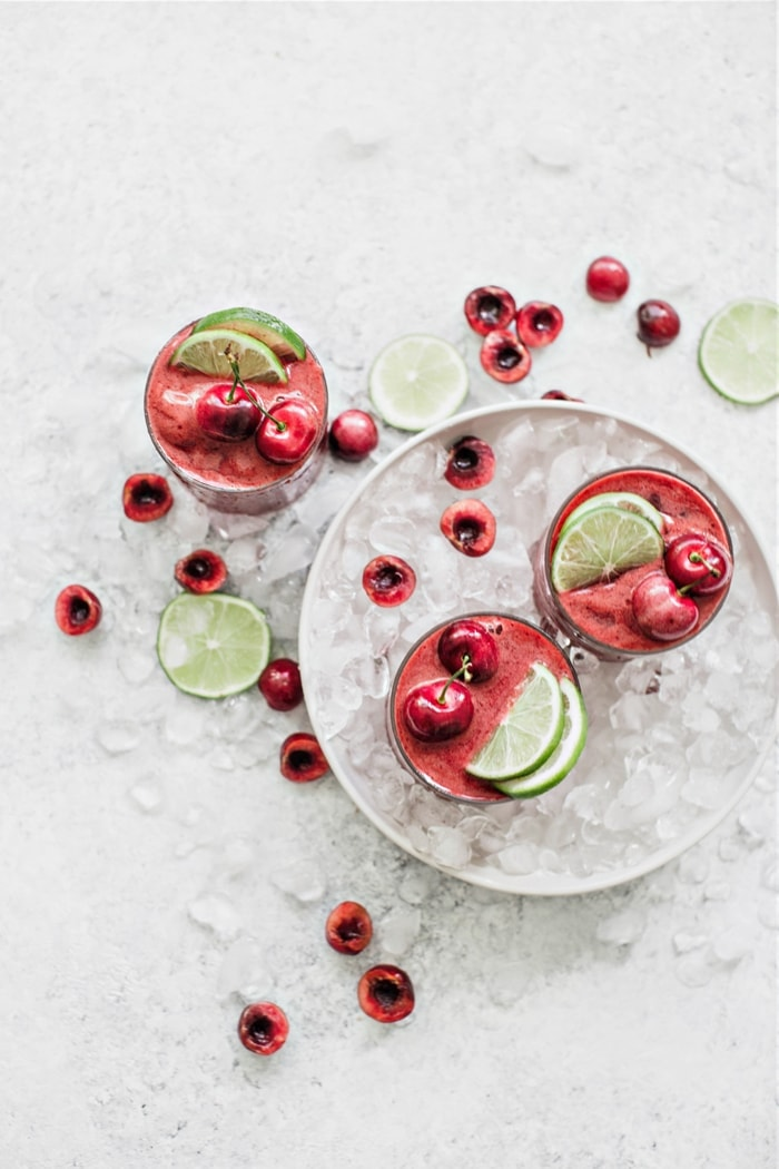 overhead images of cherry limeade slushes in a bowl with ice