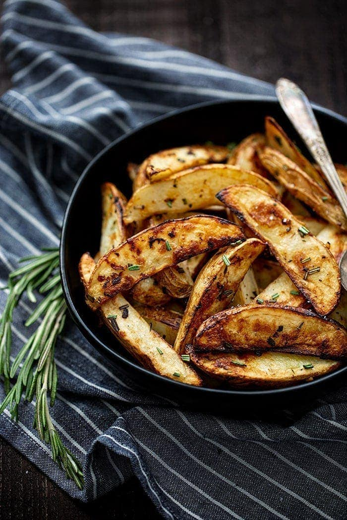 roasted potatoes in bowl with rosemary