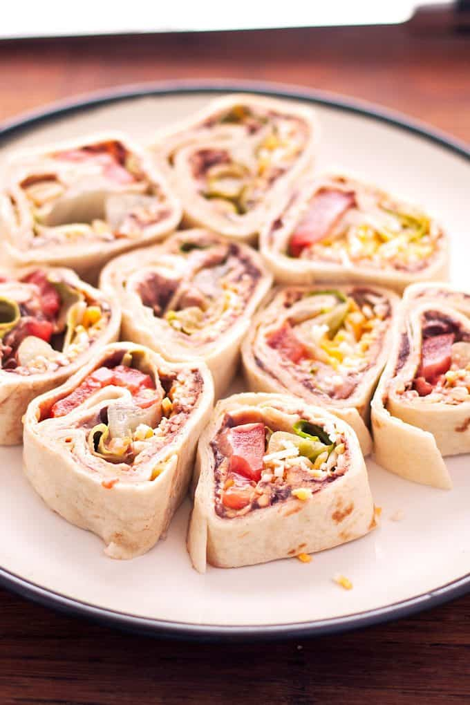 white plate filled with taco pinwheels